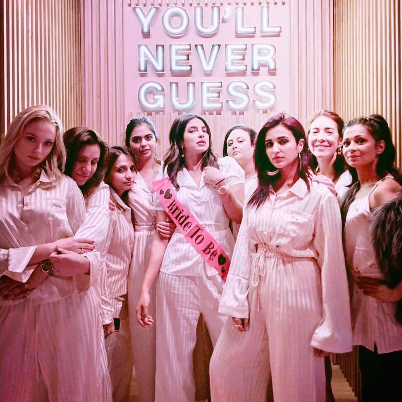 6e63cfd50e2 Priyanka Chopra Pink Striped Pajamas at Bachelorette Party ...
