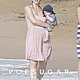 Jennifer Garner held onto baby Samuel as she dipped her feet in the water.