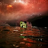A couple kissed in the water beside Copacabana Beach on New Year's Eve in Rio de Janeiro, Brazil.