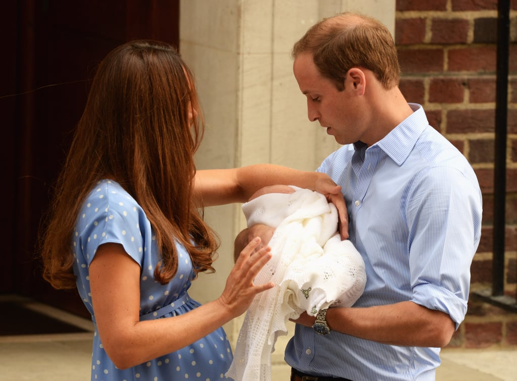 Kate Middleton gave Prince William the royal baby to hold as they left the hospital.