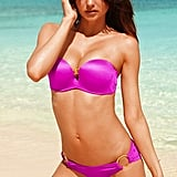 Miranda Kerr in a pink strapless bikini.
