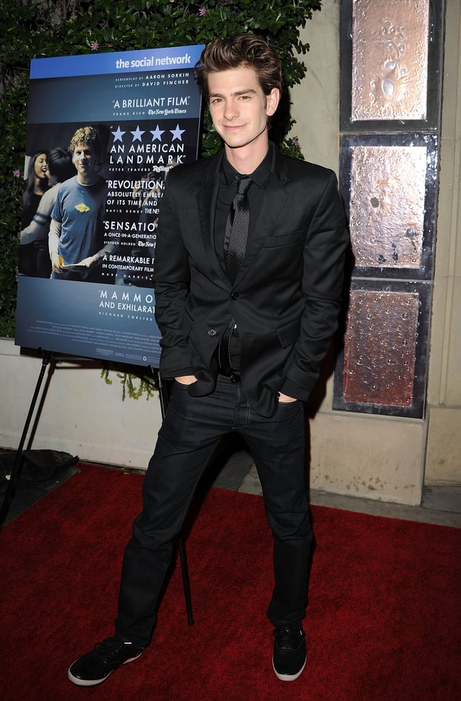 """Andrew Garfield took a break from filming Spider-Man with Emma Stone to suit up and promote the DVD of The Social Network at a party in LA last night with costar Jesse Eisenberg. Andrew is your one to watch for 2011 and he's kicked it off kissing Emma on set and talking about identifying with Peter Parker. He admitted he was bullied as a child, saying, """"Of course, every school has their bullies, and when you're a kid you wish you had the power to fight them and protect other people — and yourself."""""""