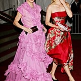 Photographers caught Amber Valletta in the middle of blowing a kiss while strolling with Linda Evangelista in 2006.