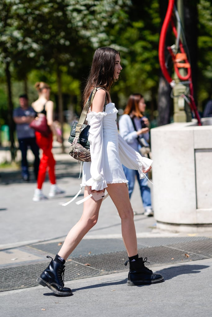 Style an off-the-shoulder minidress with black combat boots.
