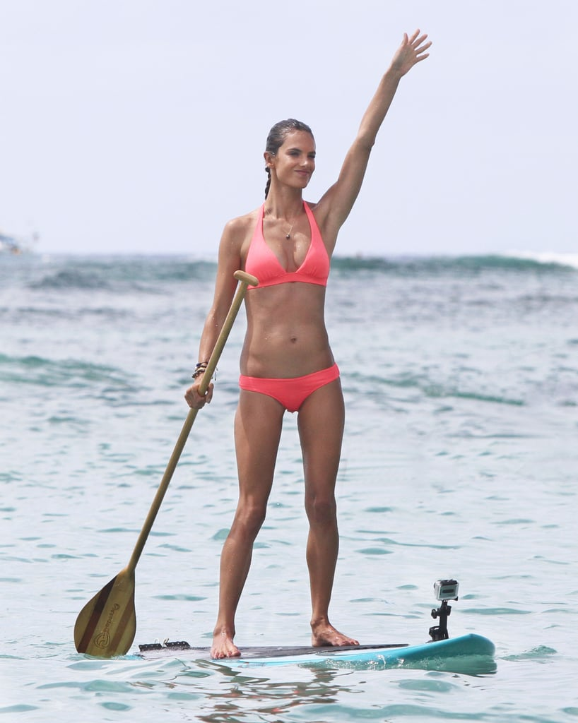 Alessandra Ambrosio wore a bright pink bikini to go paddle boarding yesterday. She's in Hawaii for the opening of a new Victoria's Secret store in Waikiki, and she promoted the brand with an appearance at its boutique on Tuesday. Alessandra has been all about the tropical locations lately since she was also in Bora Bora for a photo shoot last week. She made a quick stop back in LA before heading to Hawaii to soak up the sun, and she'll be able to show off her sexy tan next month when she models in the Victoria's Secret fashion show. She's not the only hot mom who will hit the runway, though, since Miranda Kerr will wear a $2.5 million bra at the annual event.