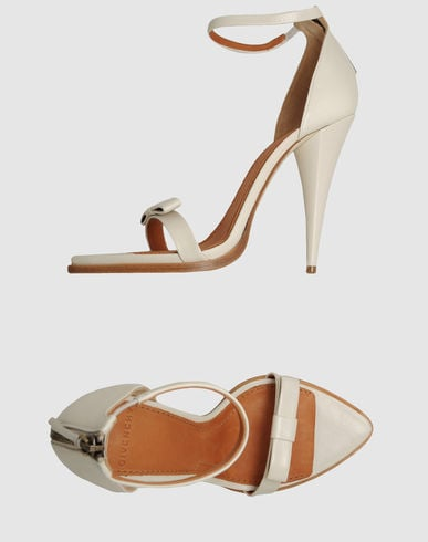 The bow detailing gives these just a touch of retro charm.  Givenchy High-Heeled Sandals ($368)