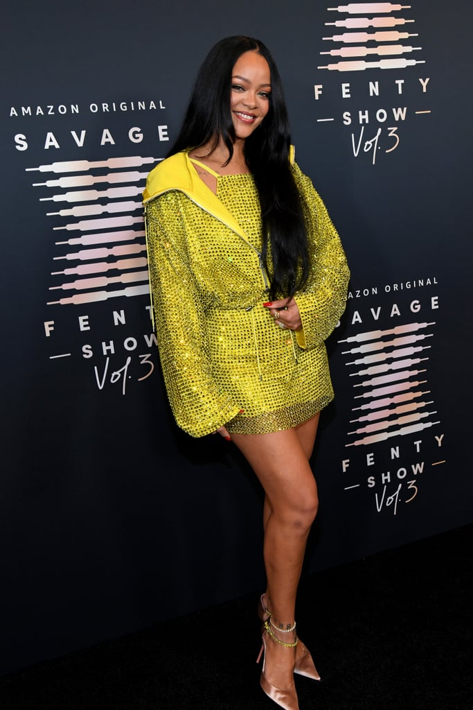 Wearing a yellow, rhinestone-covered minidress to her latest Savage X Fenty screening, Rihanna shone bright like, well, you know. The singer and aesthetics entrepreneur recently celebrated the upcoming release of her third lingerie show, which will premiere on Prime Video on Sept. 24. For the star-studded Los Angeles red carpet event, Rihanna wore a custom Bottega Veneta dress featuring a halter neckline and a zip-up hoodie layered over it.  Rihanna kept her accessories simple, teaming the sporty dress with gold rings, a diamond anklet, and satin champagne pumps with matching yellow ankle straps. See photos of her quintessentially cool look ahead, and mark your calendar for another industry-changing runway show.      Related:                                                                                                           Shop the 34 Best Pieces From Rihanna's Savage x Fenty Vol 3 Fashion Show Right Now