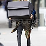 Mary-Kate Olsen carried two oversize boxes to the car in NYC.