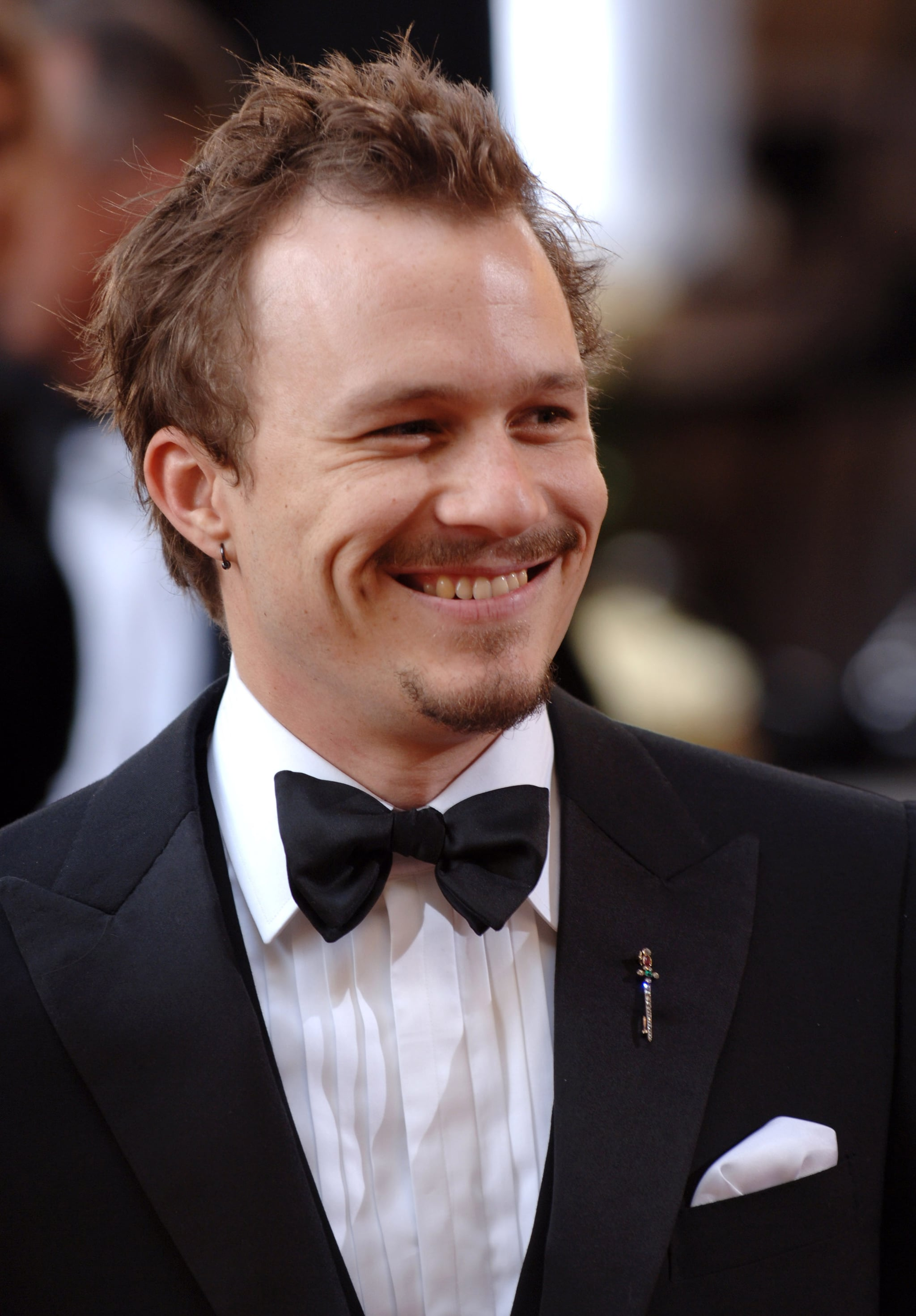 As a Hollywood A-lister with a winning smile.