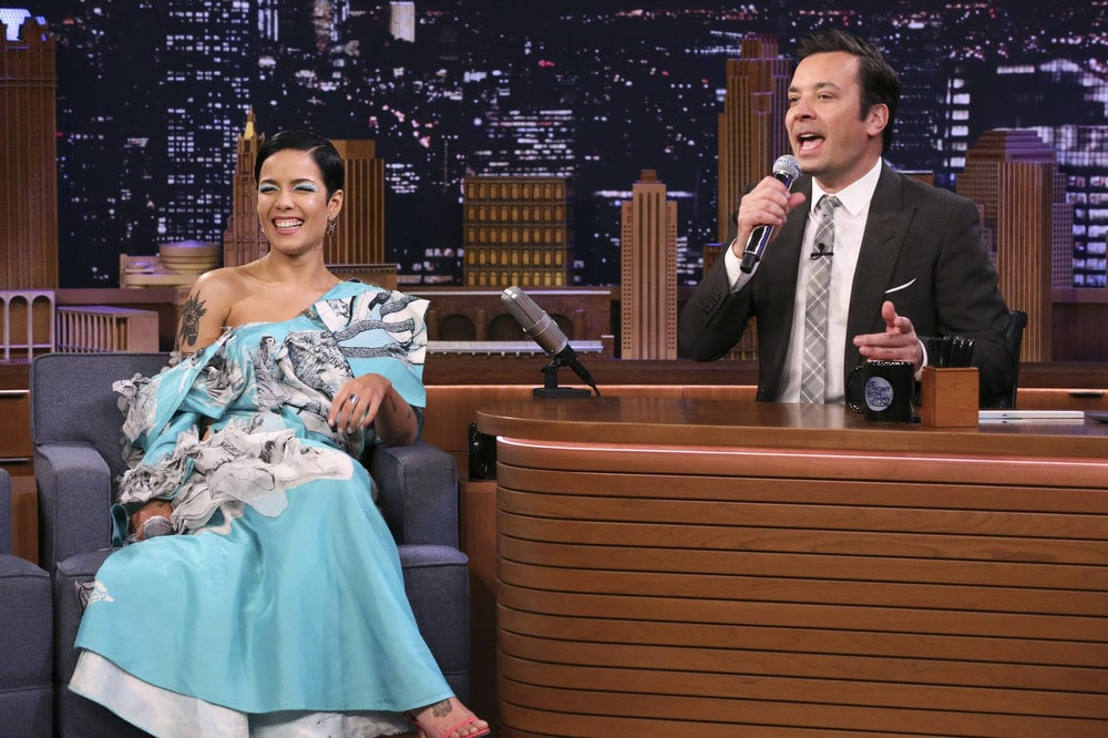 "Halsey doesn't really do subtle fashion, and it's one of the reasons we love her. The 25-year-old singer recently stopped by The Tonight Show Starring Jimmy Fallon to talk about music and sing Google Translate songs, and naturally, she wore an incredibly unique dress for the occasion.  Halsey worked with her stylist Zoe Costello to put together an outfit featuring a Hanyu Cui dress — it's truly a work of art! The one-shoulder gown shows off the designer's sketches printed against a neon blue background, with a dangerously dramatic hip-high slit. Hey, it's all about risks, and Halsey takes them well! She tied the ensemble together with bright Jimmy Choo heels and Justine Clenquet jewlery. Keep reading to see more snaps of her statement look.       Related:                                                                                                           Halsey's ""Favorite Dress"" of Her Whole Life Is a Technicolor Dream"