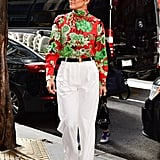 Make a Floral Top Business Appropriate With White Trousers and a Belt