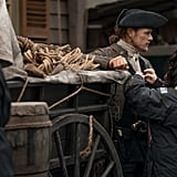 Heughan getting touched up between takes during season four.