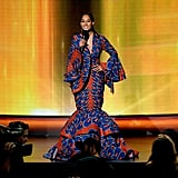 Bell sleeves, fluted skirt, and allover bold print made this look unforgettable.