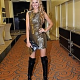 Petra Nemcova went fancy in Prague wearing a sequined minidress with bold over-the-knee, open-toe boots.