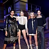 Gigi hung out backstage at Tommy Hilfiger's sailor-themed show, posing with Imaan Hammam, Hailey Baldwin, and Yasmin Wijnaldum in front of the TH Atlantic ship.