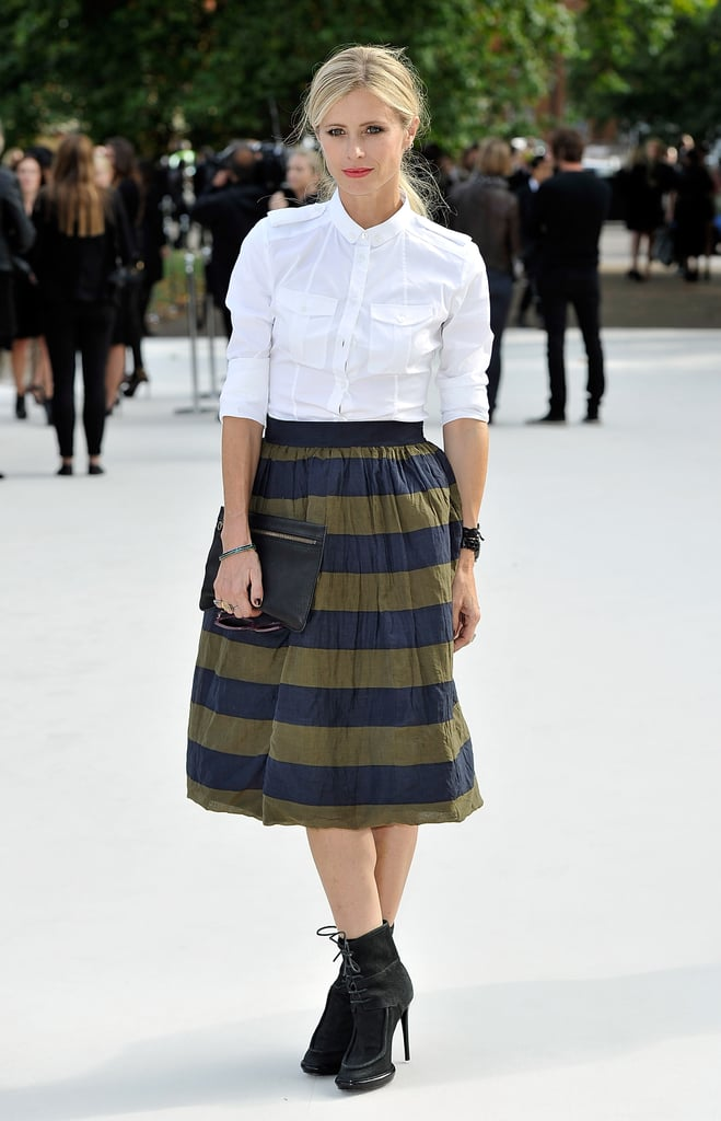 Laura Bailey opted for a striped midi skirt against a stark white blouse at Burberry.