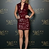 Blake Lively, the face of the Gucci Premiere fragrance, stepped out for the brand's launch party in an embellished burgundy Gucci Premiere cocktail dress. She paired simple Gucci sandals and a Gucci bracelet as the final touches.