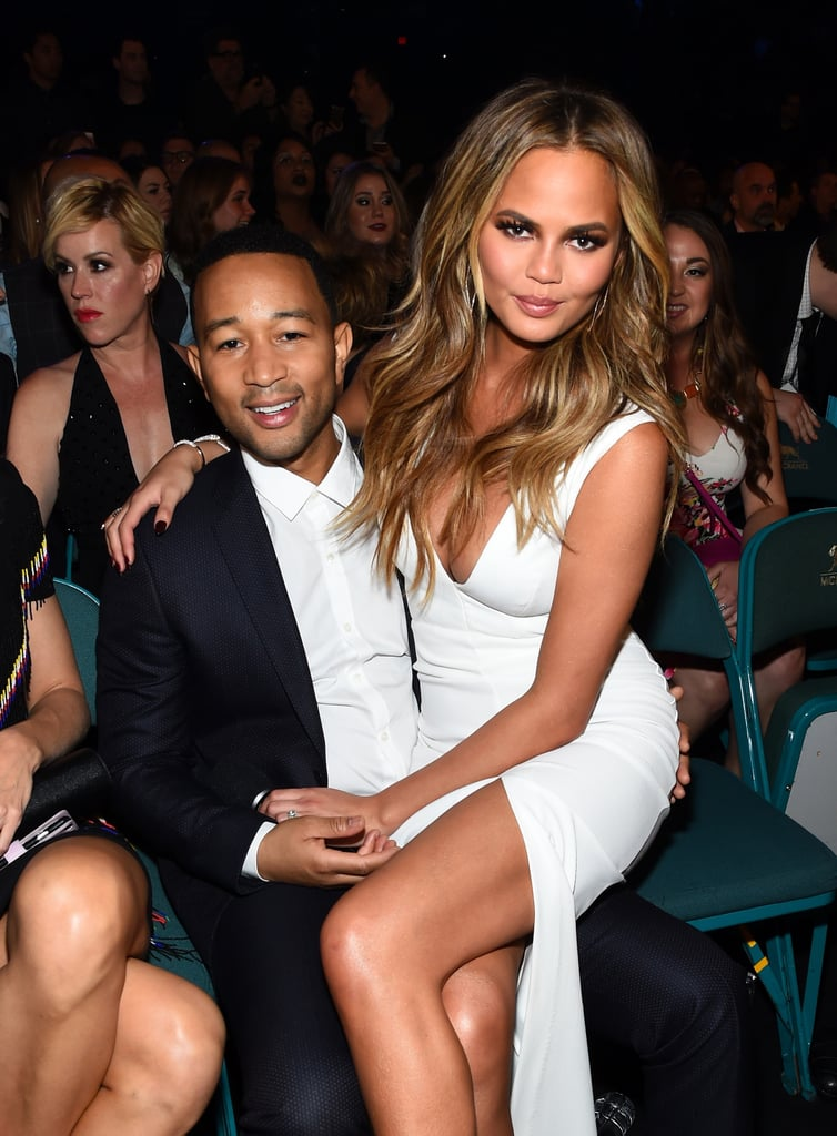 Chrissy took a seat on John's lap during the Billboard Music Awards in May 2015.