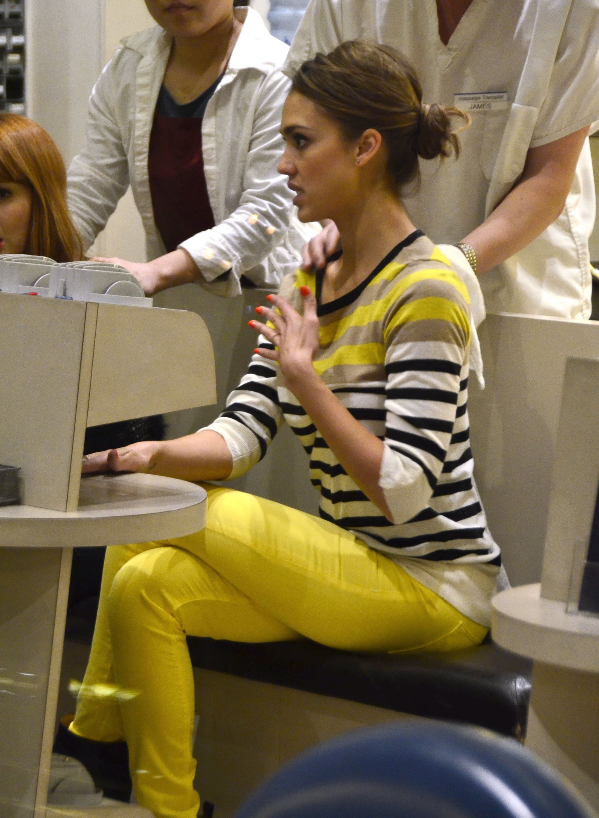 Jessica went bright for a mani-pedi session in NYC, working a striped Ann Taylor sweater, Hudson yellow skinny jeans, and punchy nail polish.