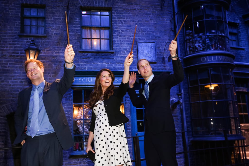 Kate Middleton, Prince Harry, and Prince William played with wands during a visit to Leavesden Studios.