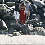Victoria Beckham pregnant on the beach with David and Brooklyn.