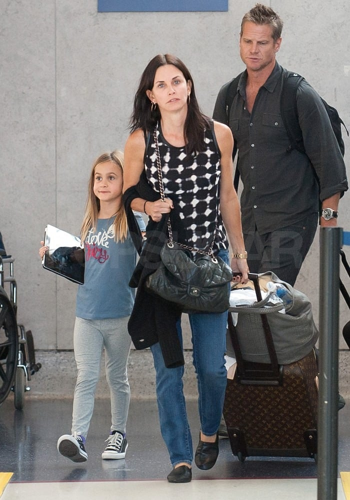 "Courteney Cox touched down at LAX yesterday with her Cougar Town costar Brian Van Holt and daughter Coco Arquette. The trio returned to the West Coast after their latest getaway. Brian, Courteney, and Coco vacationed together last Spring around the time the Cougar Town season finale was shooting in Hawaii. Brian and Courteney's show will return midseason this year, and she even got behind the camera to direct. Her estranged husband, David Arquette, is also venturing into new work territory with a stint on Dancing With the Stars. David chatted with Jay Leno recently about the mature advice Coco gave him. Seven-year-old Coco said, ""Try to be calm, breath, feel the wind in your hair, and meditate if you can."""