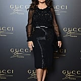 Salma Hayek was the picture of dark romance in a sheer-sleeved Gucci dress and Sergio Rossi peep-toe pumps.