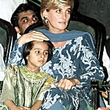 Diana stroked a young girl's hair as she visited the Shaukat Khanum Memorial Hospital during her visit to Lahore, Pakistan, in May 1997.