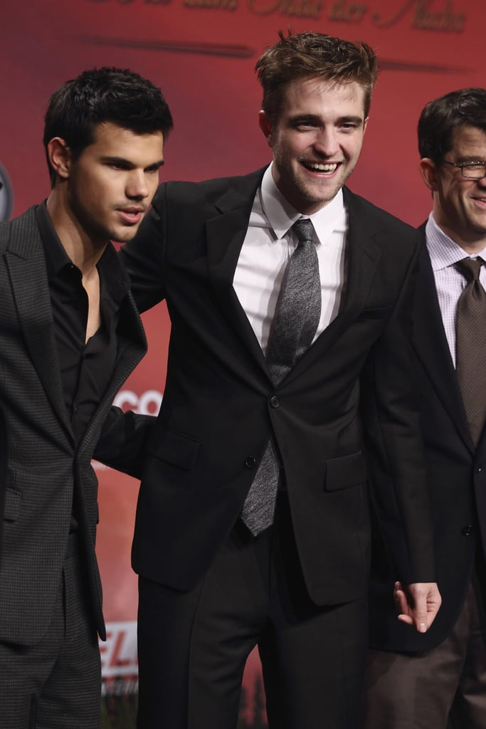 Robert Pattinson and Taylor Lautner promote Breaking Dawn Part 1 in Germany.