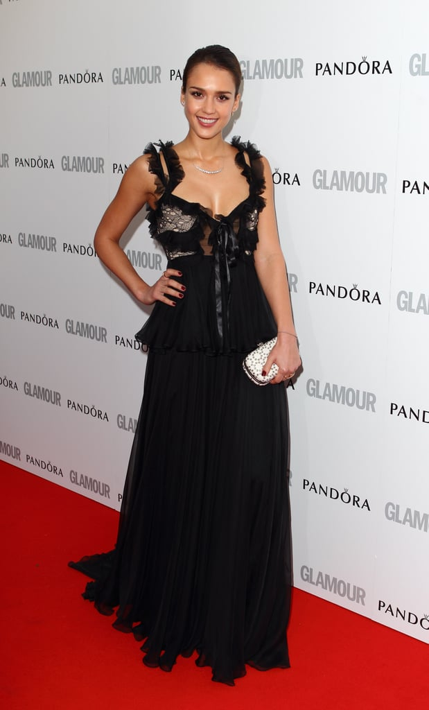 Jessica Alba opted for a darker kind of elegance in a tulle and ribbon-embellished black Alexander McQueen gown. To finish, she toted a white clutch.