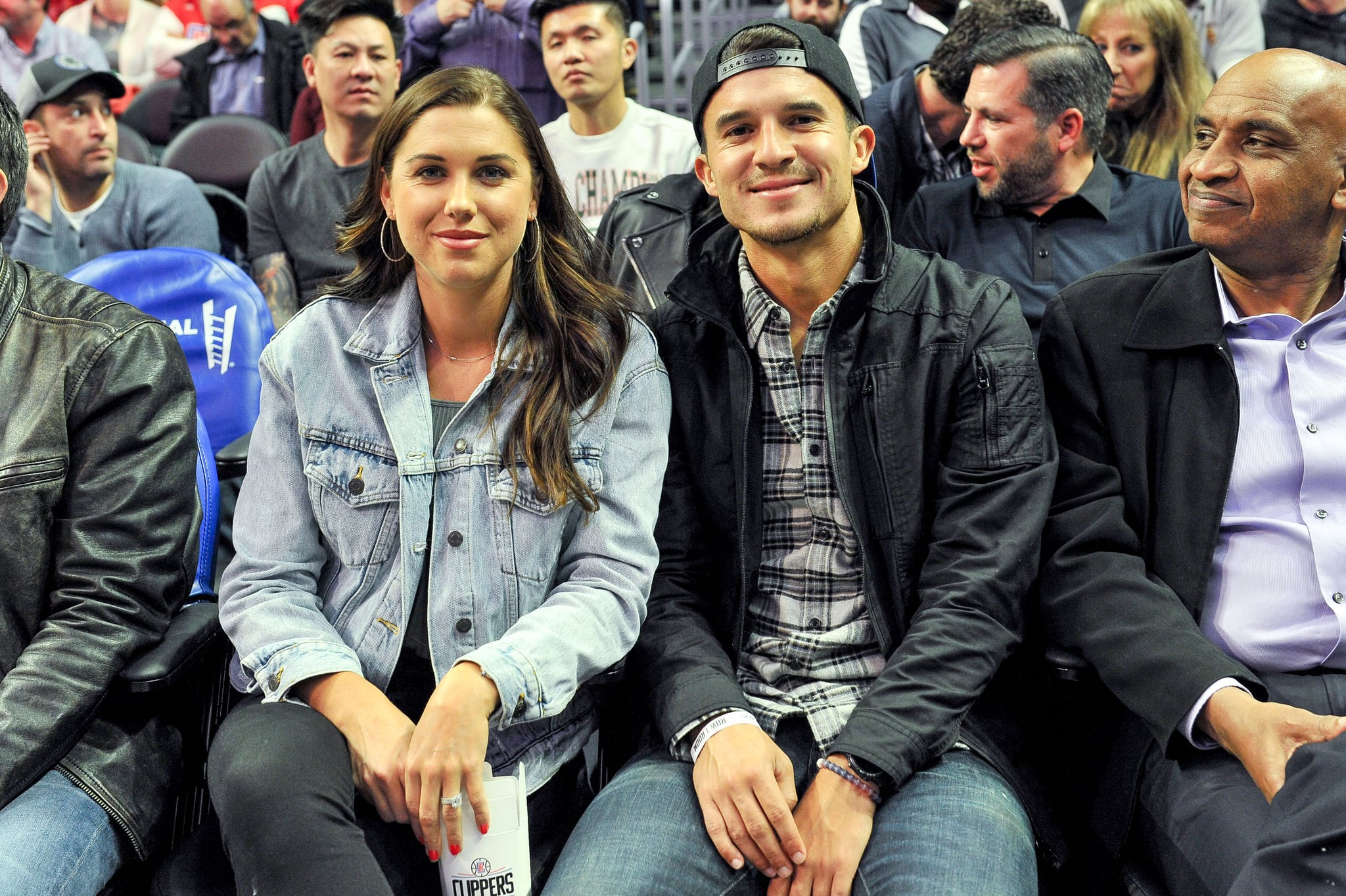 LOS ANGELES, CALIFORNIA - DECEMBER 17: Alex Morgan and Servando Carrasco attend a basketball game between the Los Angeles Clippers and the Phoenix Suns at Staples Centre on December 17, 2019 in Los Angeles, California. (Photo by Allen Berezovsky/Getty Images)