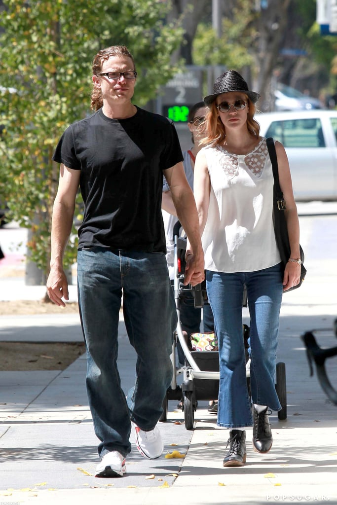 A red-headed January Jones had a man by her side to run errands around LA yesterday. The duo held hands while a nanny followed behind with January's son, Xander. January welcomed her first child last September, meaning he's just weeks shy of his big first birthday. Xander's been out and about with his mom in recent months while she's taking a break from work on Mad Men. The fifth season ended with a bang in June, and January will be back to her role as Betty Draper to start filming the sixth in October. She'll be back together with small-screen costars before then, though, since the Emmys take place on Sept. 23. Mad Men and its cast are up for multiple awards including best drama series.