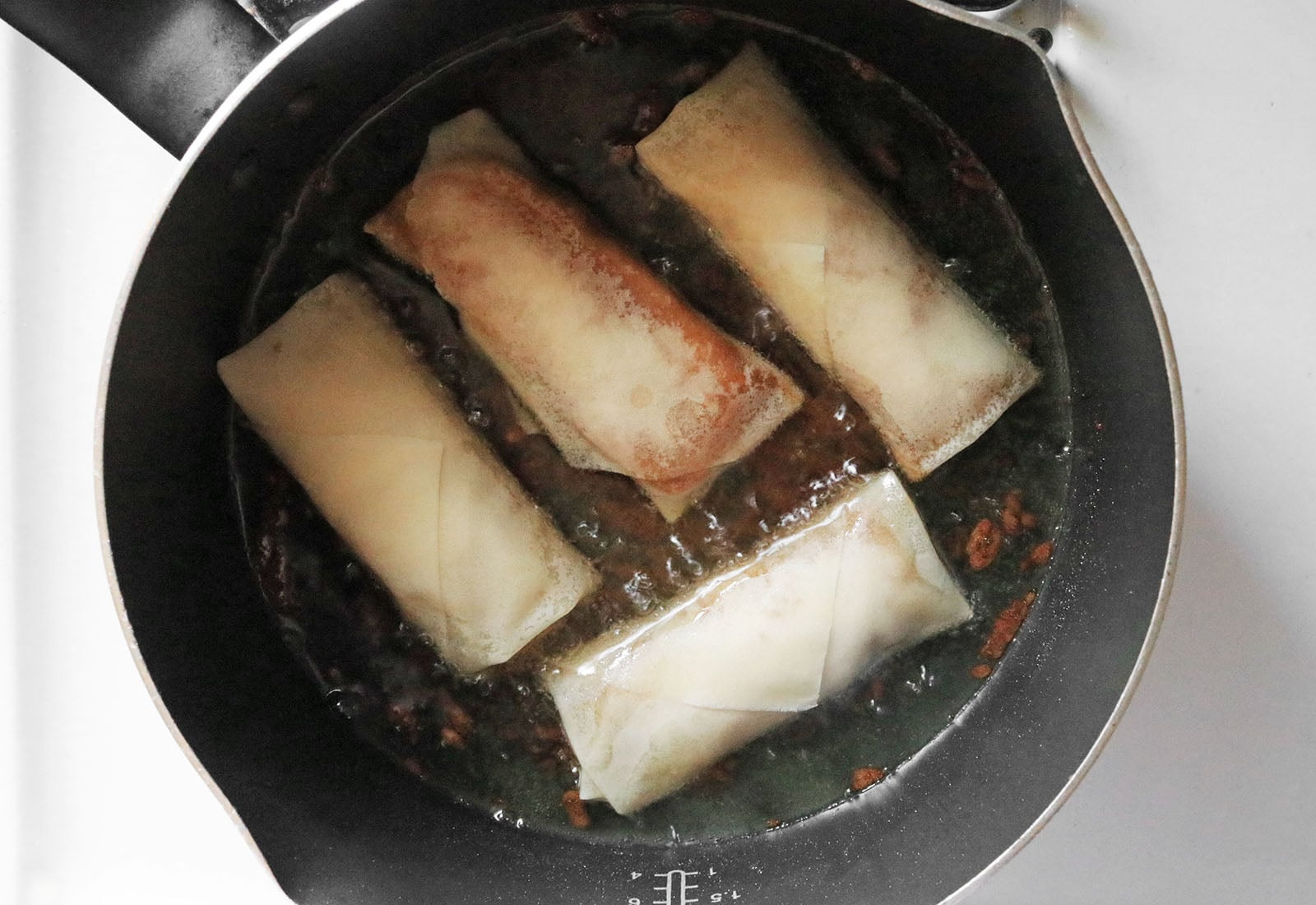 Heat oil and fry turon