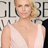A side chignon, glittering headband, and simple makeup makes Charlize Theron's 2012 Golden Globe look a complete win when it comes to Gatsby-era beauty.