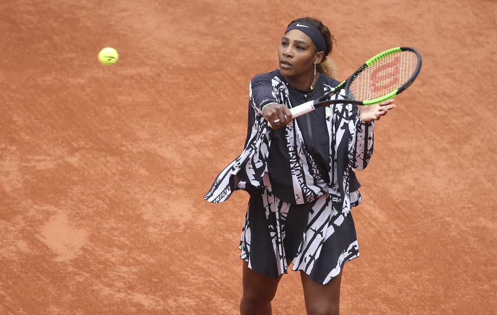 """Serena Williams made a statement in her first match at the 2019 French Open. Nearly a year after the tournament banned her from wearing bodysuits as part of its stricter dress code, the tennis player returned wearing an empowering outfit by Nike and Virgil Abloh's Off-White featuring the words mother, champion, queen, and goddess in French. The black-and-white outfit consisted of a miniskirt, crop top with a mesh bodysuit underneath, and a zip-up jacket that fittingly resembled a cape. Once the match got underway, Serena took off the jacket and later changed into a more formfitting one, also by Nike. Serena has always been one to push fashion boundaries both on and off the court, and she clearly isn't letting seemingly arbitrary dress codes get in her way. (Oh, and by the way, she won the match.)      Related:                                                                                                           Serena Williams's Outfit Isn't a Leotard — It's a Badass """"Serena-tard,"""" Thank You Very Much"""