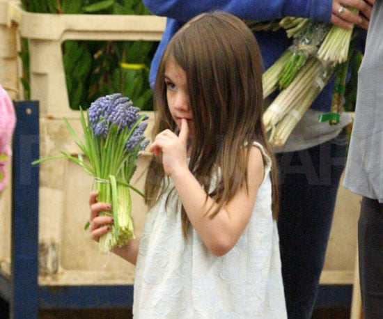 Slide Picture of Suri Cruise Holding Flowers