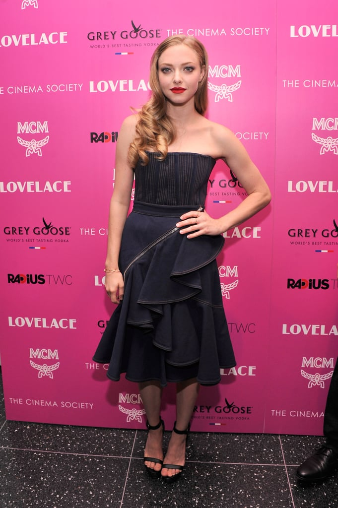 For the Lovelace screening in NYC, Amanda Seyfried was reminiscent of a flamenco dancer in a dark blue corset with a ruffled skirt and black ankle-strap sandals, all by Givenchy.