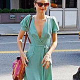 Miranda Kerr showed off her figure in a teal dress.