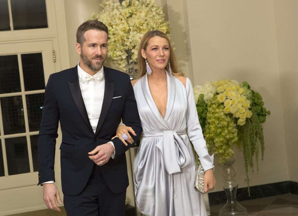 Ryan Reynolds and Blake Lively were all smiles as they arrived for the State Dinner at the White House in Washington DC on Thursday. Blake brought a dose of sex appeal in a satin robe dress with a thigh-high slit, and the startlingly good-looking couple stayed close and shared a laugh as they made their way into the event, which was held in honor of Canada's Prime Minister, Justin Trudeau, and his wife, Sophie. Ryan, as you may remember, hails from Vancouver, and his fellow Canadian stars Michael J. Fox, Mike Myers, and Sandra Oh were also on hand for the glamorous evening. This is just the third time we've seen Blake and Ryan hit the red carpet together since welcoming their daughter, James, back in January 2015; Blake stepped out to support her man at a fan event for his superhero film Deadpool, and days later, they attended the amfAR New York Gala in Manhattan. Keep reading to see the couple's elegant night at the White House.