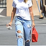 Style Your T-Shirt With: Jeans, Sandals, And a Bag
