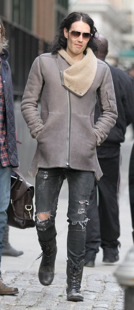 Russell Brand wore ripped jeans as he headed to the airport in New York yesterday. He was looking much more smart the night before, at the Cosmopolitan Fun Fearless Man awards, where he met up with his Forgetting Sarah Marshall costar Mila Kunis and showed support for Charlie Sheen. He passed on his Happy Pancake Day wishes to the rest of Britain yesterday, while his wife Katy Perry has been rocking a blue wig with Kanye West in France for PFW.
