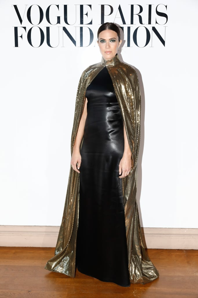17891c6e921c6 Mandy Moore in Gold Cape in Paris   POPSUGAR Fashion