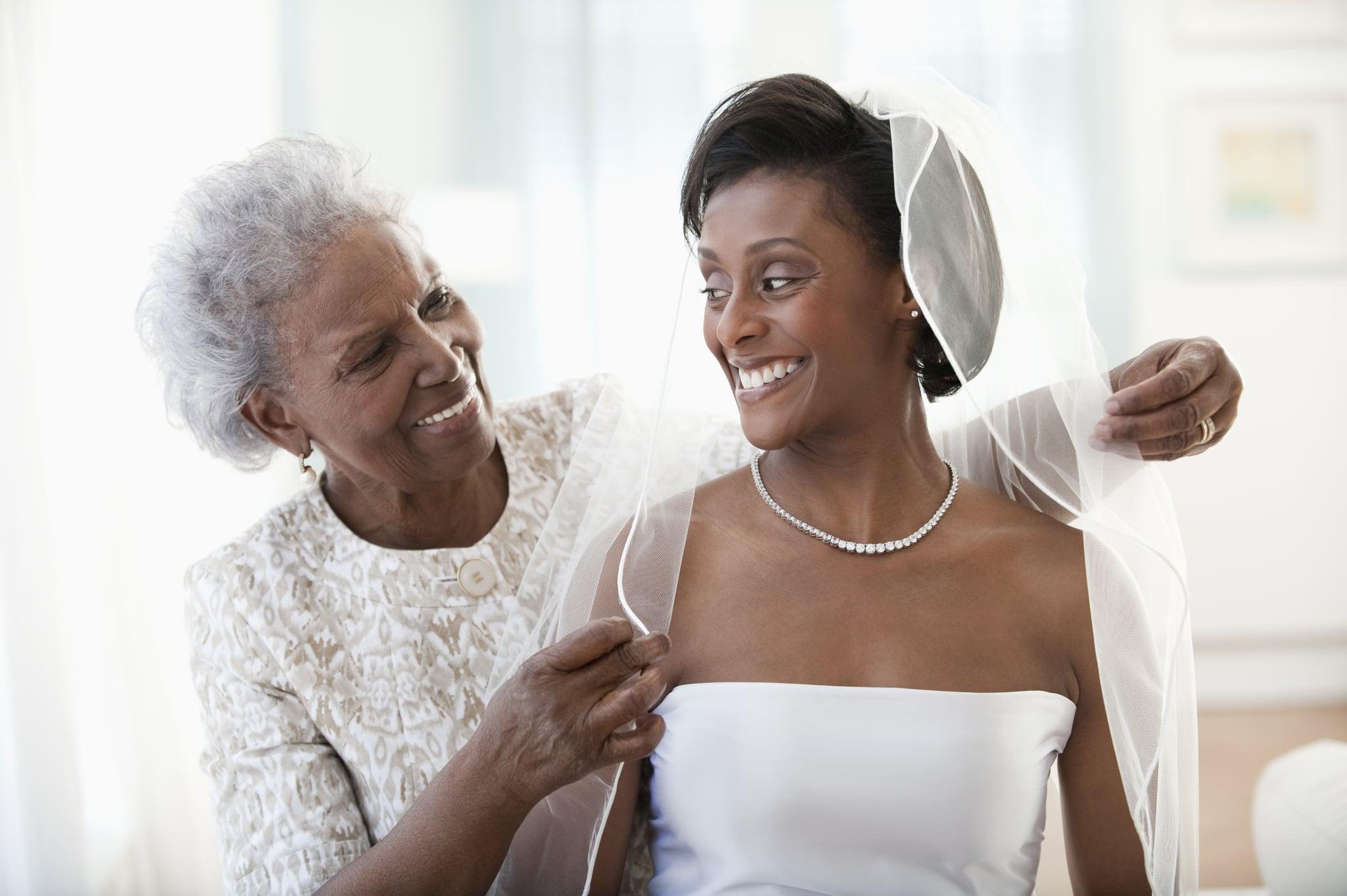 Grandmother helping granddaughter get ready on wedding