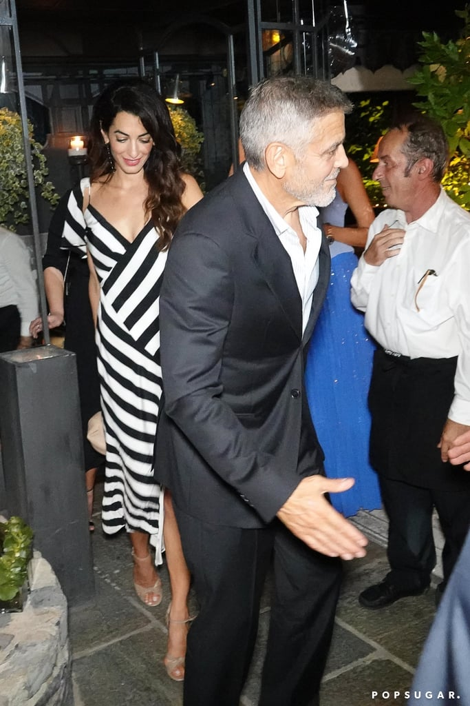 George Clooney seems to be recovering just fine following his motorbike incident last month. On Friday night, George and Amal stepped out for dinner with friends at Gatto Nero in Lake Como, Italy. The couple appeared to be in good spirits as Amal flashed a big smile and George held her hand while escorting her out of the restaurant. What a gentleman! Amal, of course, stunned in a black-and-white striped dress and George looked suave in a suit.  Back in July, George was struck by a car in Olbia while driving his motorbike. The actor was rushed to a nearby hospital but was released shortly after and reportedly sustained minor injuries. We're glad to see George is doing much better!      Related:                                                                                                           Sorry to Bother You, but Amal and George Clooney Look EVEN Better in Black and White