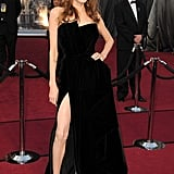 Angelina Jolie showed off her leg in a high-slit gown at the February 2012 Academy Awards.