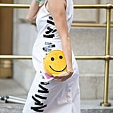 Eva Chen's smiley face clutch sends out bright, cheery vibes.