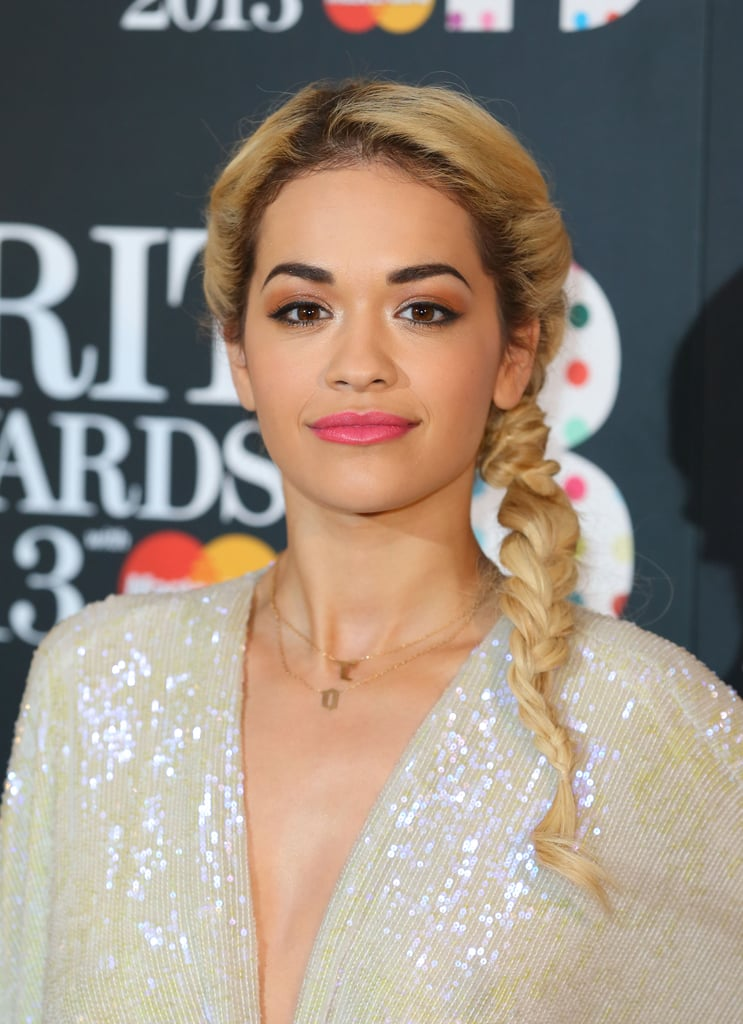 A twisted ponytail, like Rita Ora's at the Brit Awards, adds a fun twist to the classic style.