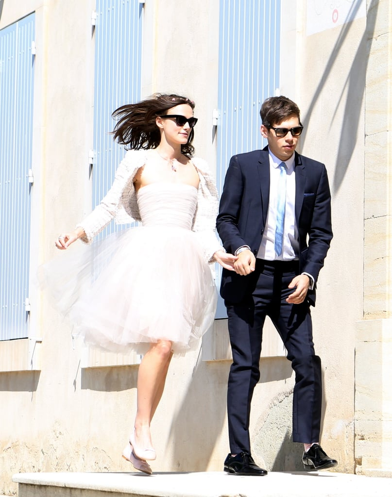 On Saturday, Keira Knightley and James Righton were married in France! The couple were spotted skipping together, and the bride reportedly chose a blush-hued strapless confection by Rodarte. To finish it all off, she styled her low-key look with a floral wreath, a Chanel tweed jacket, ballet flats, and cat-eye sunglasses. Source: Spread/X17Online.com