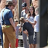 David Beckham held son Cruz Beckham's hand with Romeo Beckham and Brooklyn Beckham nearby at Disneyland.