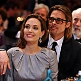 Brad Pitt lovingly draped an arm around Angelina Jolie.